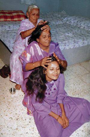 Three generations of Indian head massage