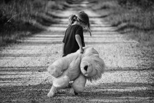 Girl dragging teddy | Anxiety in children